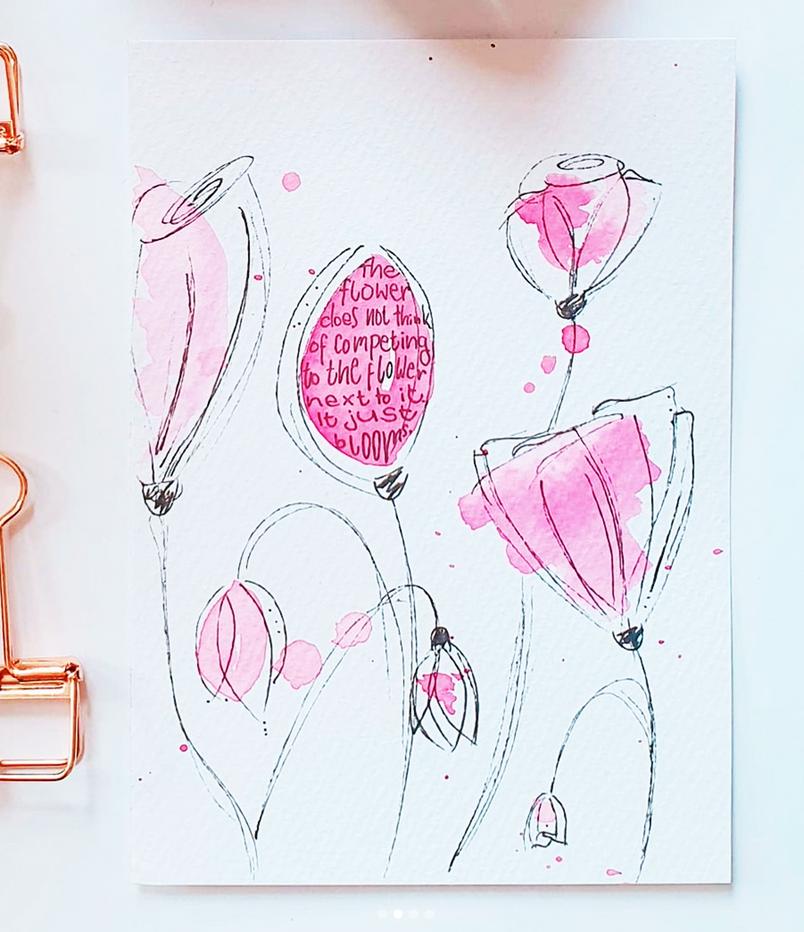 Hand Lettering in Form einer schoenen Blüte